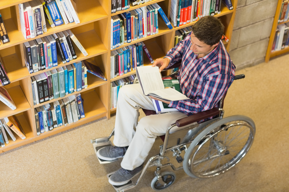 Young person with a book in the library