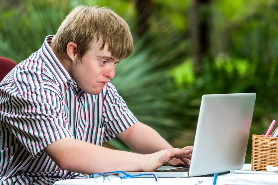 Young person using a laptop