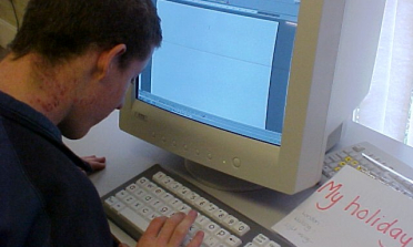 image of a young person working at a computer