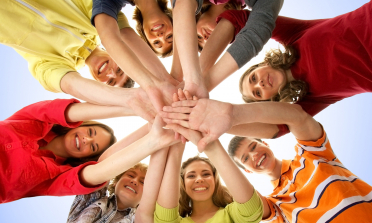 young people forming a circle with their hands