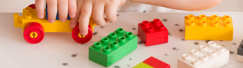 young children playing with colourful lego