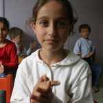 Children clap to music in a preschool at the Social Services and Child Protection agency in Istanbul