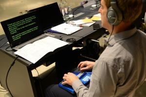 image of young person using assistive technology