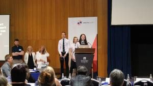 students speaking at the event in Malta